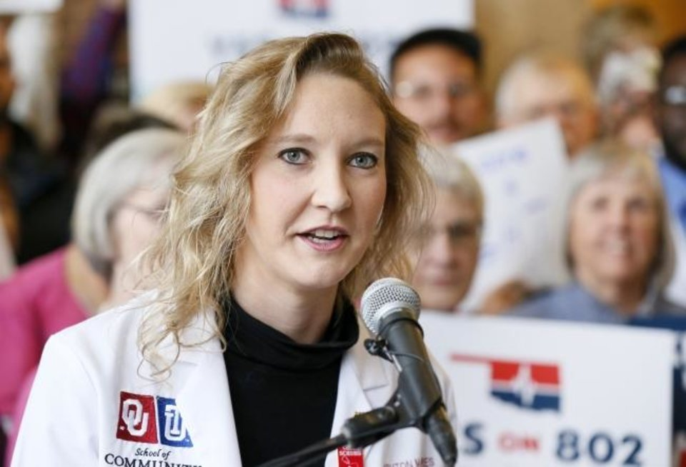 Photo -  Ashton Gores, a medical student and volunteer with Yes on 802, speaks in front of Medicaid expansion supporters before they delivered petitions for State Question 802 to the Oklahoma secretary of state's office on Thursday. [Nate Billings/The Oklahoman]