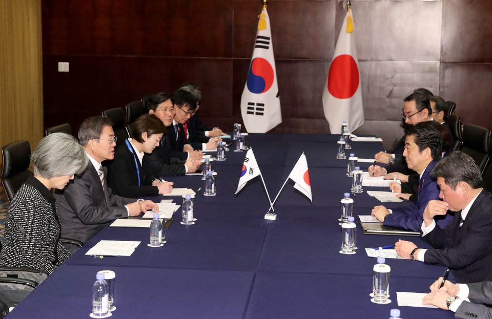 Photo -  South Korean President Moon Jae-in, second from left, talks with Japanese Prime Minister Shinzo Abe, second from right, during a meeting in Chengdu, China, Tuesday, Dec. 24, 2019. (Lee Jin-wook/Yonhap via AP)