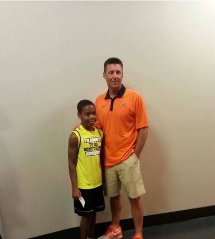 Photo -  Jaden Nixon, left, began attending Mike Gundy's Oklahoma State football camps at a young age. [PHOTO PROVIDED]
