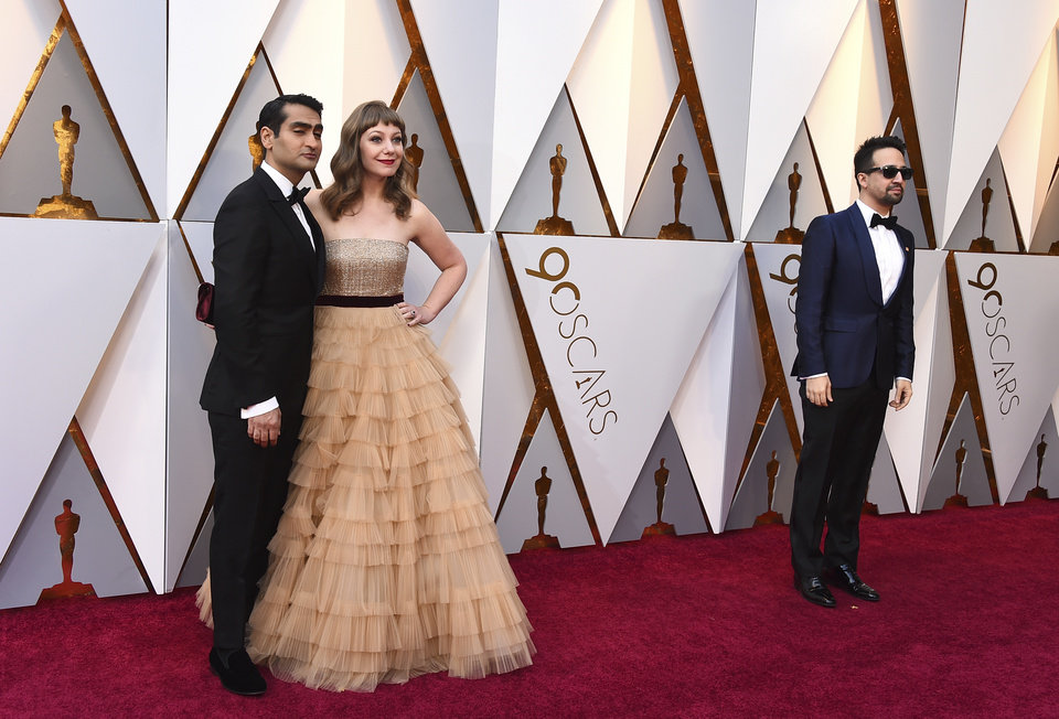 Photo - Kumail Nanjiani, from left, Emily V. Gordon, and Lin-Manuel Miranda arrive at the Oscars on Sunday, March 4, 2018, at the Dolby Theatre in Los Angeles. (Photo by Jordan Strauss/Invision/AP)