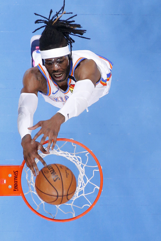 Photo - Oklahoma City's Nerlens Noel (9) dunks the ball during an NBA basketball game between the Oklahoma City Thunder and the Cleveland Cavaliers at Chesapeake Energy Arena in Oklahoma City, Wednesday, Feb. 5, 2020. Oklahoma City won 109-103. [Bryan Terry/The Oklahoman]