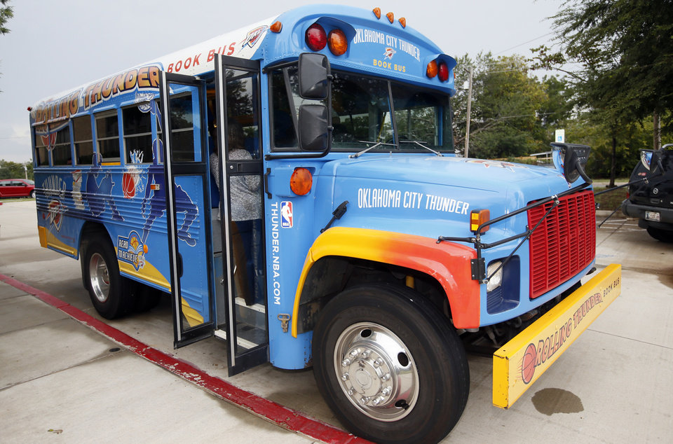 Photo - The Oklahoma City Thunder's Rolling Thunder Book Bus at Sequoyah Elementary, 2400 NW 36th St., in Oklahoma City, Thursday, Sept. 15, 2016. Photo by Nate Billings, The Oklahoman