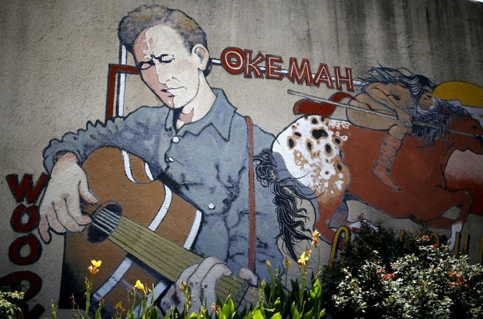 Photo - A mural is pictured on the side of a building during the 2016 Woody Guthrie Folk Festival in Okemah. [Photo by Sarah Phipps, The Oklahoman Archives]