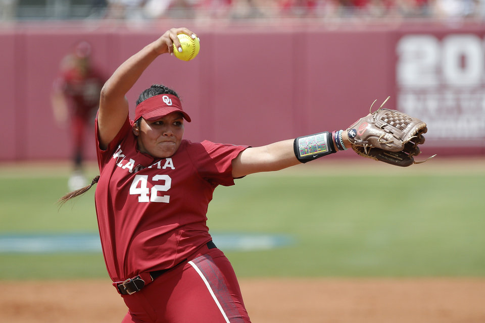 Photo - Oklahoma's Mariah Lopez (42) pitches during the second softball game in the Norman Super Regional between the University of Oklahoma (OU) and Northwestern in Norman, Okla., Saturday, May 25, 2019. Oklahoma won 8-0 to send them to the Women's College World Series. [Bryan Terry/The Oklahoman]