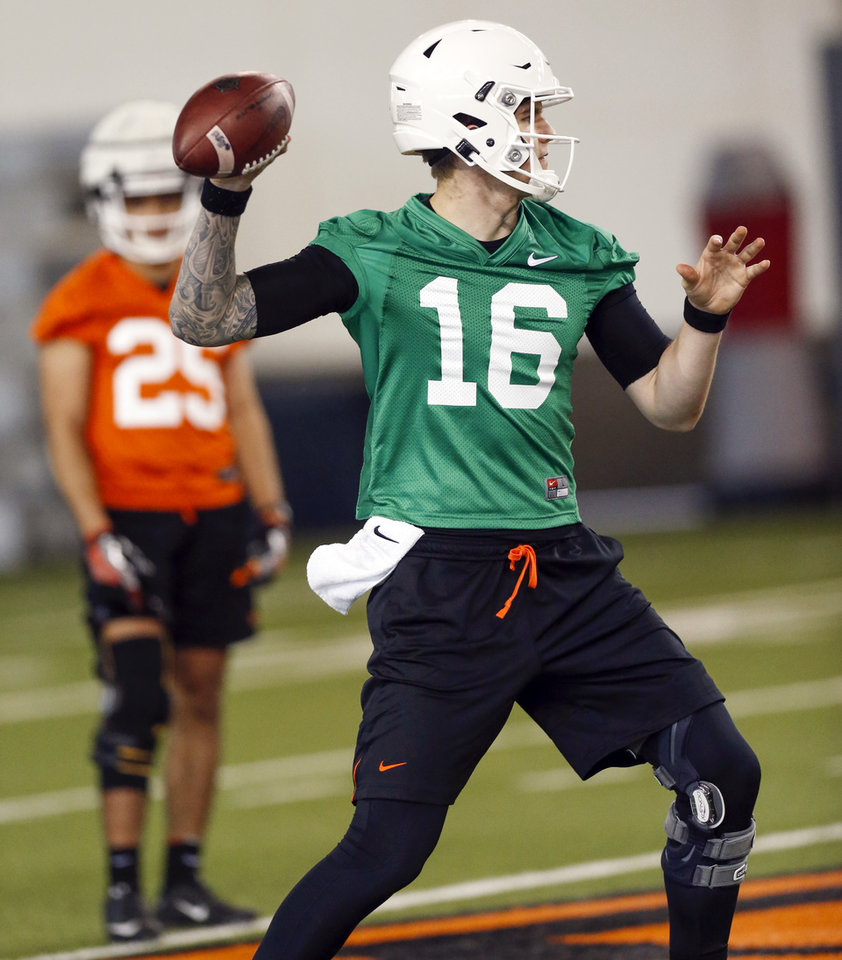 Photo - OSU quarterback Shane Illingworth (16) passes during the first spring football practice for the Oklahoma State Cowboys at the Sherman E. Smith Training Center in Stillwater, Okla., Monday, March 9, 2020. [Nate Billings/The Oklahoman]