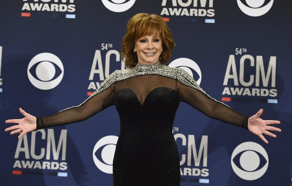 Photo - Reba McEntire poses in the press room at the 54th annual Academy of Country Music Awards at the MGM Grand Garden Arena on Sunday, April 7, 2019, in Las Vegas. (Photo by Jordan Strauss/Invision/AP)