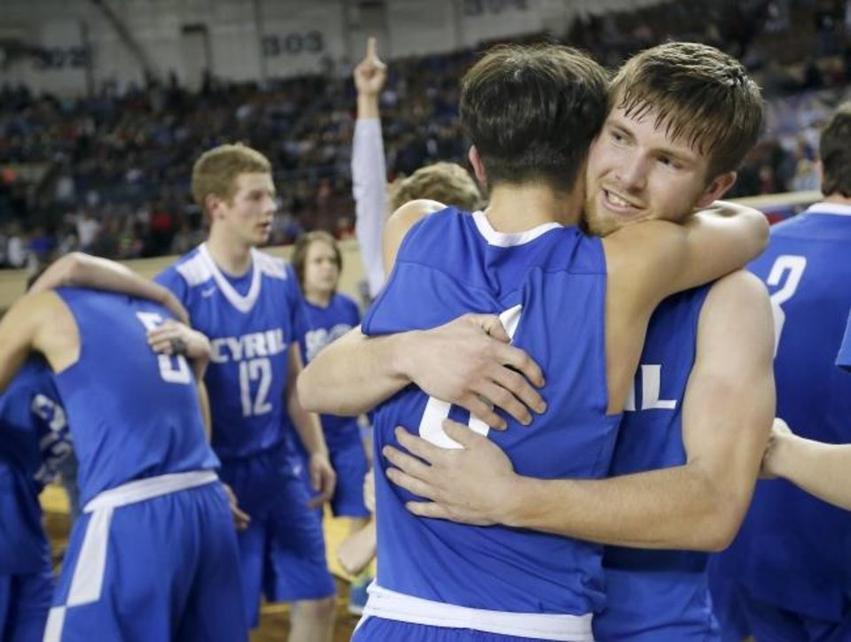 Photo -  Cyril's Jakobie Kaesemeyer and Cason McLemore , right, hug after winning the Class A state title Saturday. [Sarah Phipps/The Oklahoman]