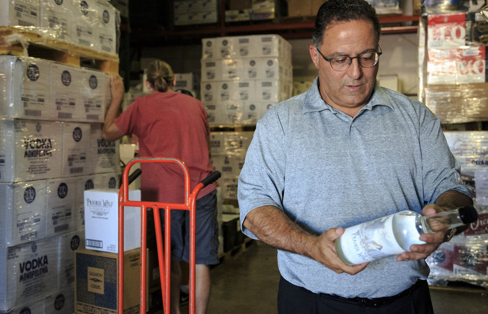 Photo - ​Ricky Naifeh, owner of Premium Brands Wines and Spirits, talks about upcoming changes in Oklahoma liquor laws at his warehouse in Oklahoma City, Okla. on Wednesday, Sept. 19, 2018. Photo by Chris Landsberger, The Oklahoman