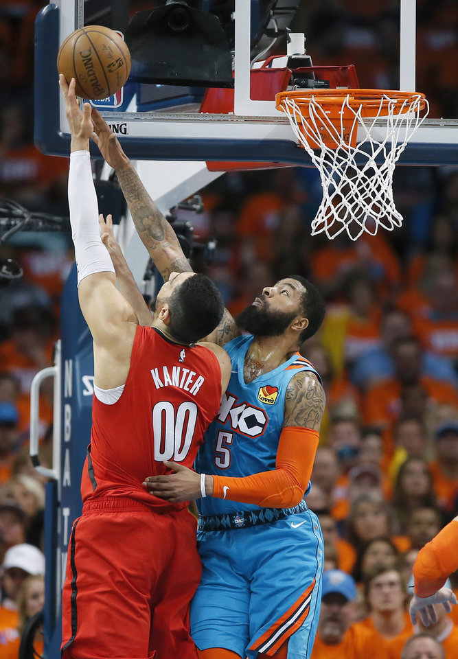 Photo - Oklahoma City's Markieff Morris (5) defends Portland's Enes Kanter (00) during Game 3 in the first round of the NBA playoffs between the Portland Trail Blazers and the Oklahoma City Thunder at Chesapeake Energy Arena in Oklahoma City, Friday, April 19, 2019. Photo by Bryan Terry, The Oklahoman