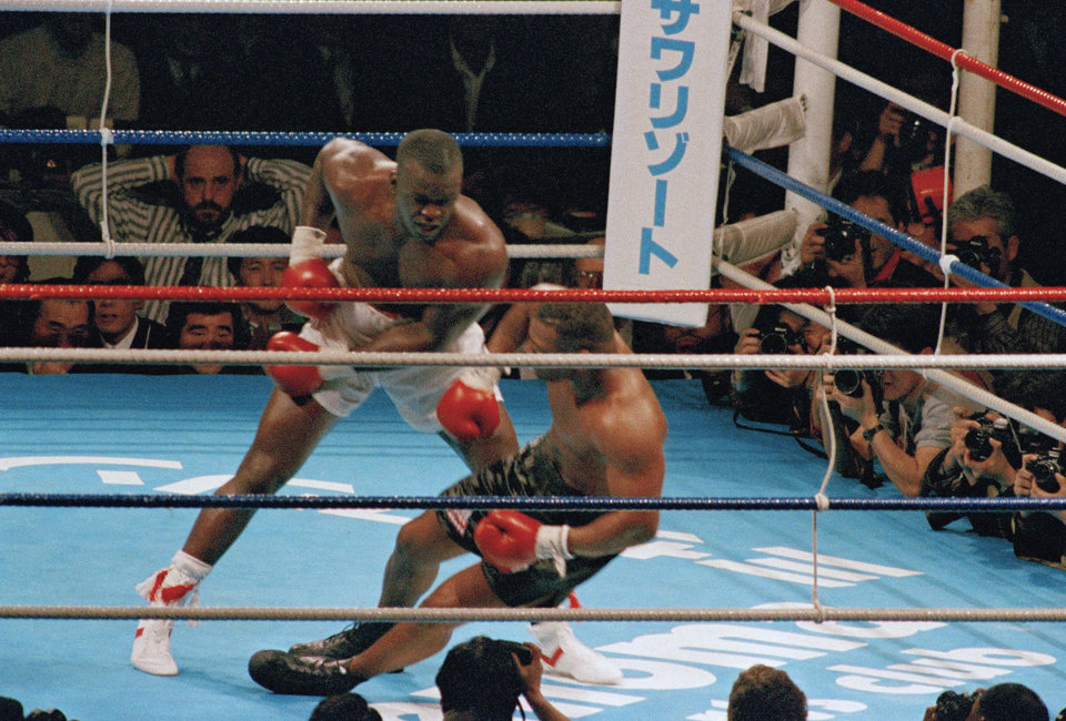 Photo -  Buster Douglas, left, drops Mike Tyson in the 10th round of one of boxing's biggest upsets in Tokyo on Feb. 11, 1990. [AP PHOTO]