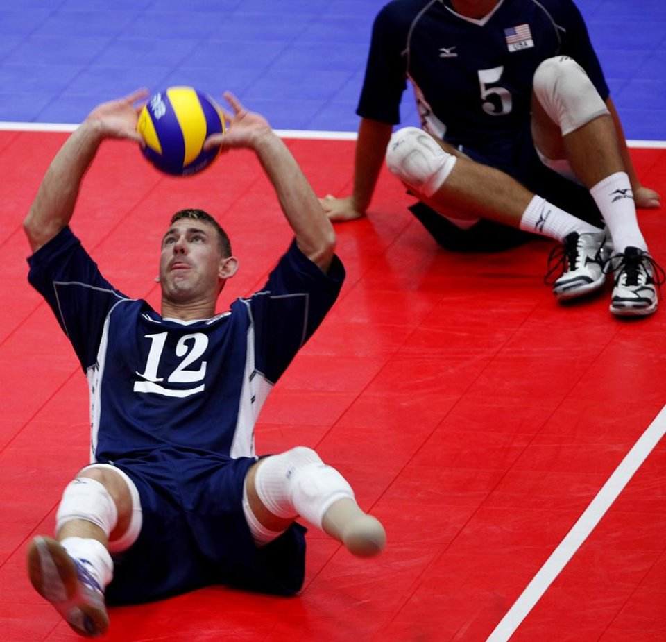 Photo -  UCO: Brent Rasmussen sets the ball during a match against China at the Sitting Volleyball World Championships at Hamilton Field House on the University of Central Oklahoma campus in Edmond, Okla. Sunday, July 11, 2010.  Photo by Miranda Grubbs, The Oklahoman ORG XMIT: KOD
