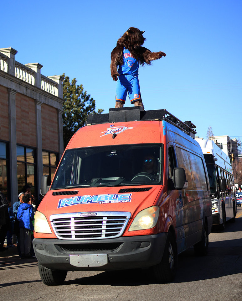Photo - The Thunder's Rumble greets the crowd at the MLK Day Parade during celebration of Dr. Martin Luther King, Jr. holiday, Monday, January 20, 2019. [Photo by Doug Hoke/The Oklahoman]