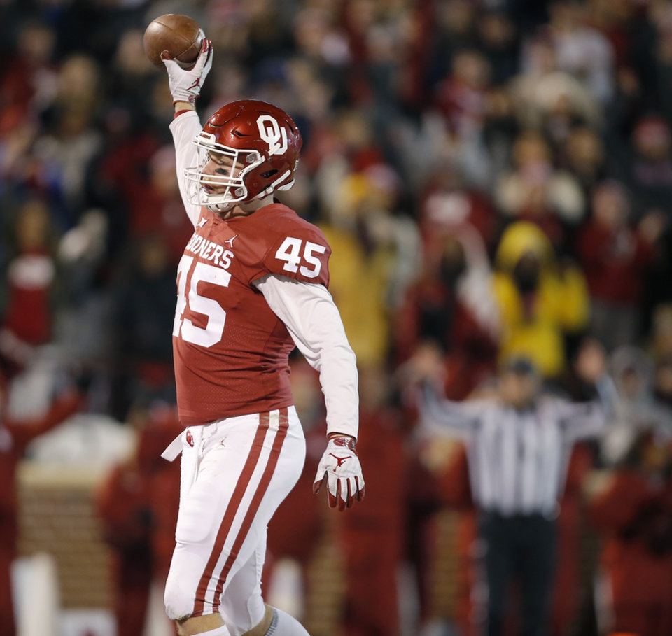 Photo - Oklahoma's Carson Meier (45) celebrates after scoring a touchdown during a college football game between the University of Oklahoma Sooners (OU) and the Kansas Jayhawks (KU) at Gaylord Family-Oklahoma Memorial Stadium in Norman, Okla., Saturday, Nov. 17, 2018. Photo by Bryan Terry, The Oklahoman