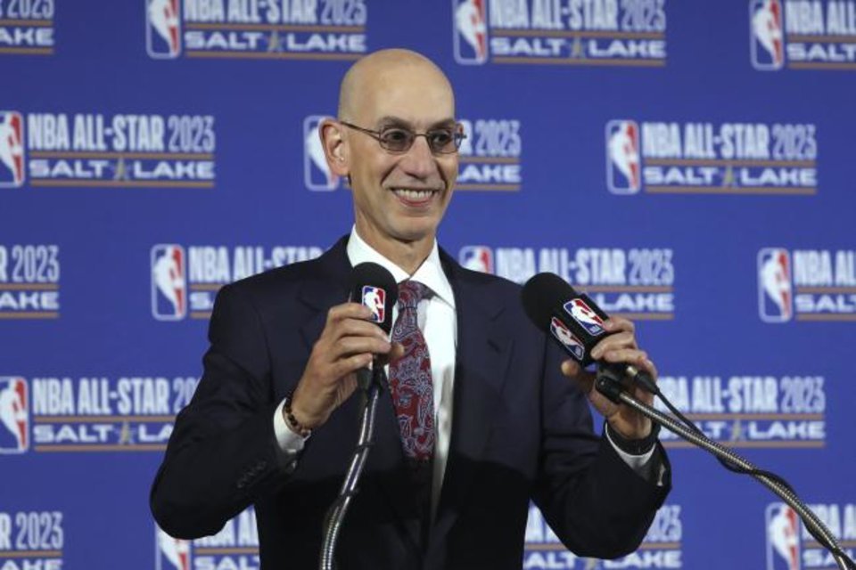 Photo -  FILE - In this Oct. 23, 2019, file photo, NBA Commissioner Adam Silver speaks during a news conference at Vivint Smart Home Arena in Salt Lake City. Something is finally clear in the uncertain NBA. Players believe they're going to play games again this season. The obvious questions like how, where and when remain unanswered. (AP Photo/Rick Bowmer, File)