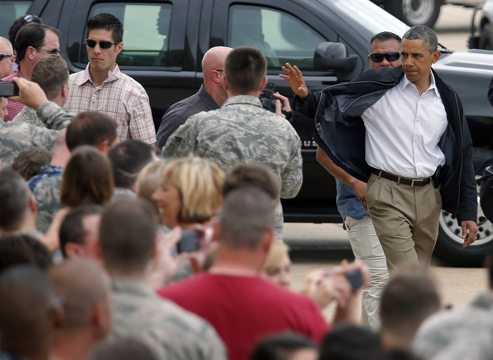 Photo - President Barack Obama waves to the crowd at Tinker Air Force base in Midwest City, Sunday, May 26, 2013. Obama was in town to visit areas damaged by the May 20 tornado. Photo by Sarah Phipps, The Oklahoman