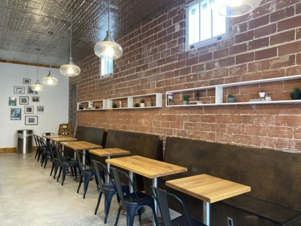 Photo -  The coffee shop at Fulton Street Books & Coffee opened in September at 210 W Latimar in Tulsa. [Carla Hinton/The Oklahoman]