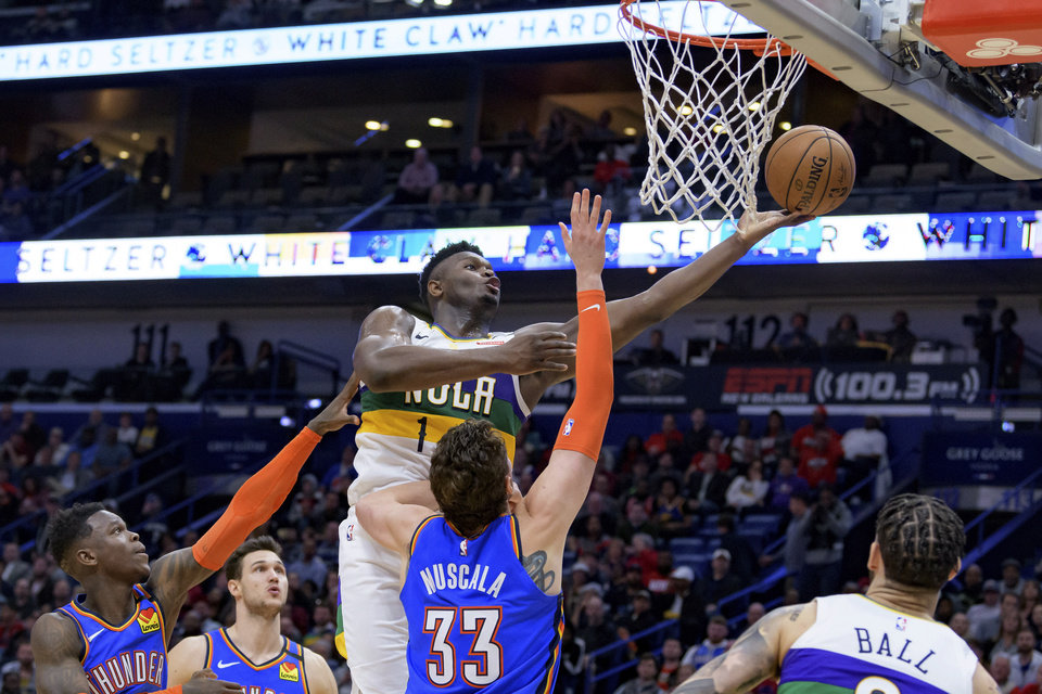 Photo - New Orleans Pelicans forward Zion Williamson (1) shoots over Oklahoma City Thunder forward Mike Muscala (33) during the second half of an NBA basketball game in New Orleans, Thursday, Feb. 13, 2020. (AP Photo/Matthew Hinton)