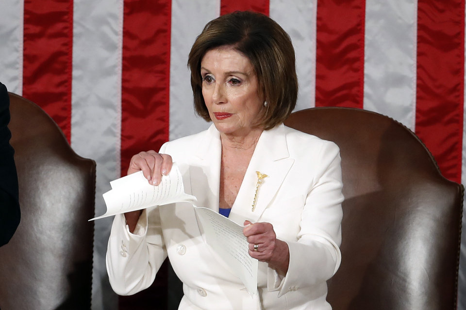 Photo -  House Speaker Nancy Pelosi of Calif., tears her copy of President Donald Trump's State of the Union address after he delivered it to a joint session of Congress on Capitol Hill in Washington, Tuesday, Feb. 4, 2020. (AP Photo/Alex Brandon)