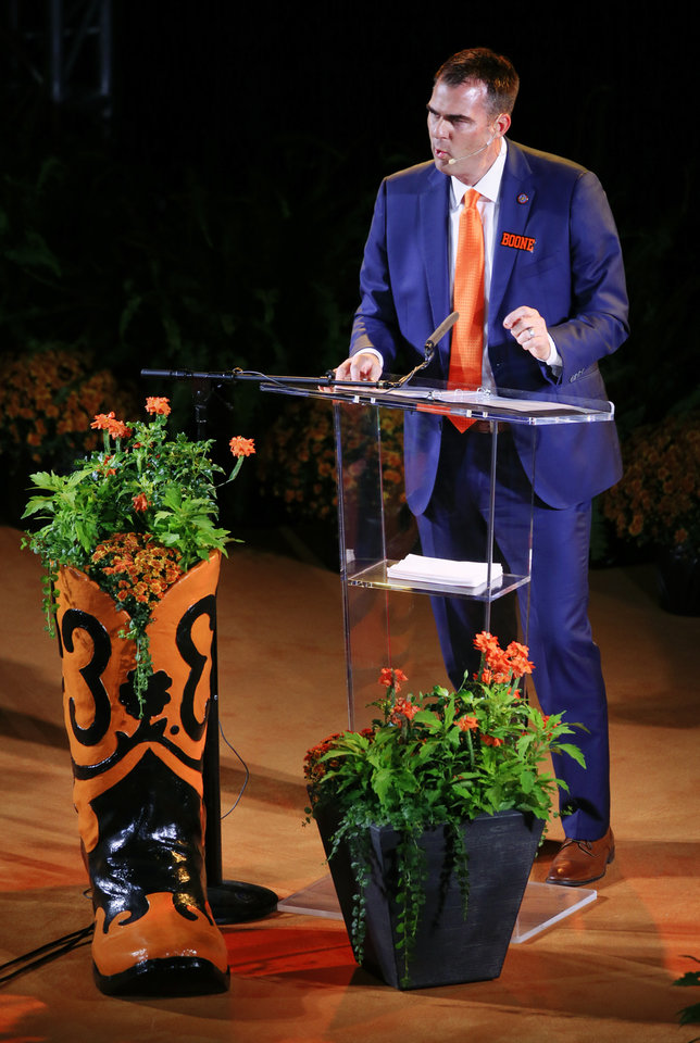 Photo - Gov. Kevin Stitt speaks during the Celebration of Life for OSU alumnus and benefactor T. Boone Pickens at Gallagher-Iba Arena in Stillwater, Okla., Wednesday, Sept. 25, 2019. [Nate Billings/The Oklahoman]