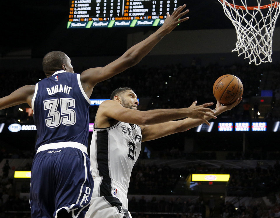 Photo - San Antonio's Tim Duncan (21) goes past Oklahoma City's Kevin Durant (35) during Game 1 of the second-round series between the Oklahoma City Thunder and the San Antonio Spurs in the NBA playoffs at the AT&T Center in San Antonio, Saturday, April 30, 2016. San Antonio won 124-92. Photo by Bryan Terry, The Oklahoman
