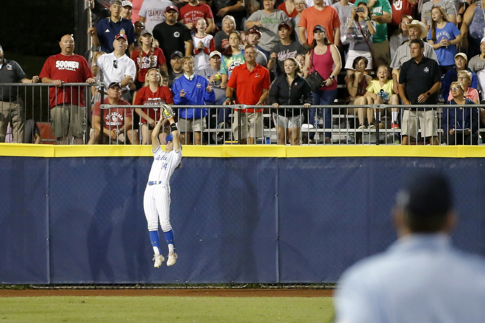 Photo - UCLA's Kelli Godin catches the ball for an out in the seventh inning of the second NCAA softball game in the championship series of the Women's College World Series between Oklahoma and UCLA at USA Softball Hall of Fame Stadium in Oklahoma City, Tuesday, June 4, 2019. UCLA won 5-4. [Bryan Terry/The Oklahoman]