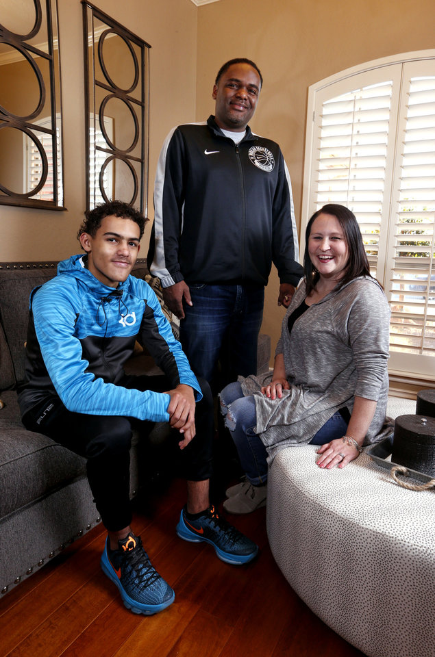 Photo - Norman North basketball player Trae Young sits with his father Ray and mother Candice on Wednesday, Jan. 27, 2016, in Norman, Okla.  Photo by Steve Sisney, The Oklahoman