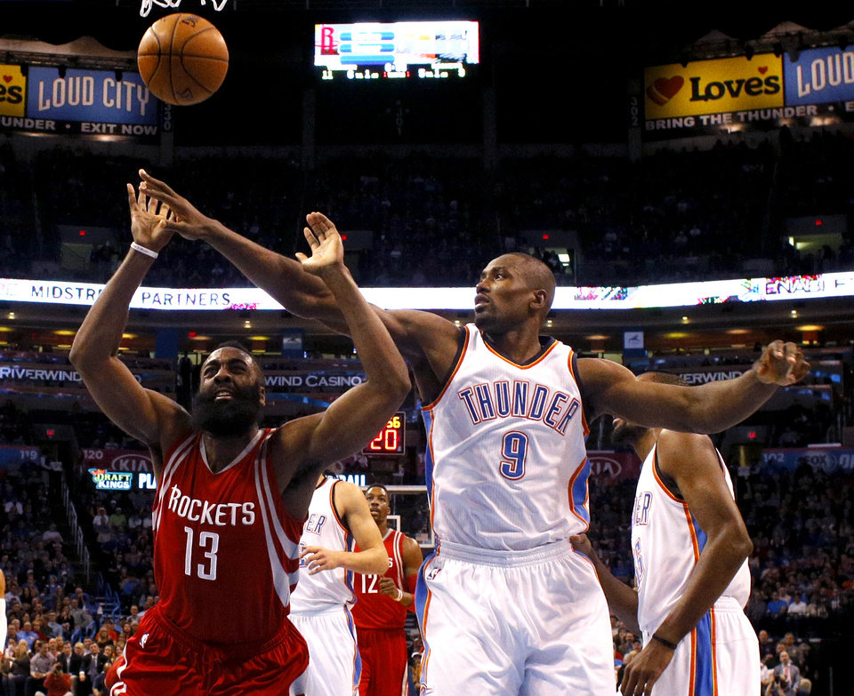 Photo - Oklahoma City's Serge Ibaka (9) defends Houston's James Harden (13) during an NBA basketball game between the Oklahoma City Thunder and the Houston Rockets at Chesapeake Energy Arena in Oklahoma City, Friday, Jan. 29, 2016. Oklahoma City won 116-108. Photo by Bryan Terry, The Oklahoman