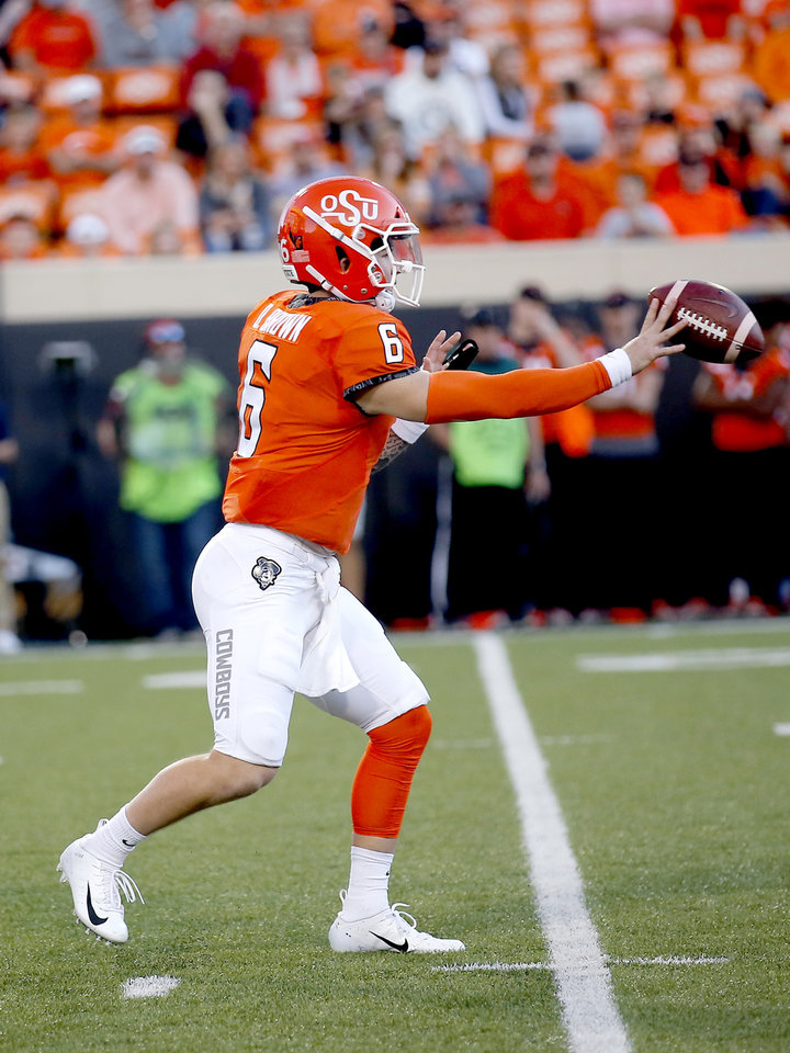Photo - Oklahoma State's Dru Brown (6) throws a shovel pass the fourth quarter during the college football game between Oklahoma State University and Baylor at Boone Pickens Stadium in Stillwater, Okla., Saturday, Oct. 19, 2019. Baylor won 45-27. [Sarah Phipps/The Oklahoman]