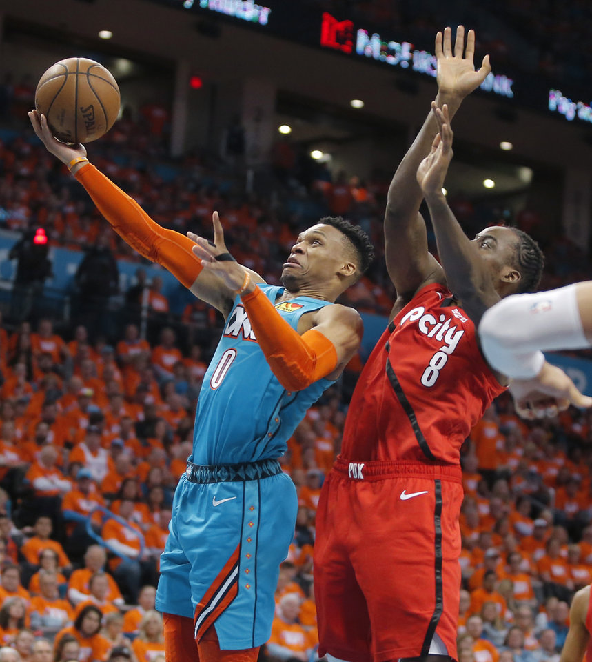 Photo - Oklahoma City's Russell Westbrook (0) goes to the basket past Portland's Al-Farouq Aminu (8) during Game 3 in the first round of the NBA playoffs between the Portland Trail Blazers and the Oklahoma City Thunder at Chesapeake Energy Arena in Oklahoma City, Friday, April 19, 2019. Oklahoma City won 120-108. Photo by Bryan Terry, The Oklahoman