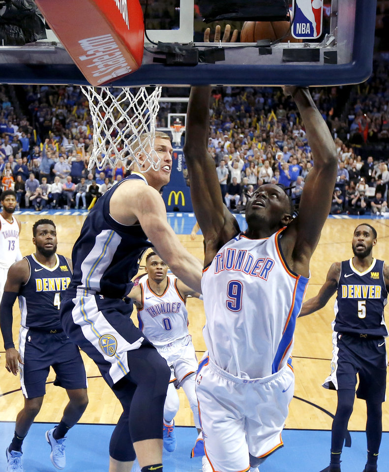 Photo - Denver's Mason Plumlee (24) blocks the shot of Oklahoma City's Jerami Grant (9) during an NBA basketball game between the Oklahoma City Thunder and the Denver Nuggets at Chesapeake Energy Arena in Oklahoma City, Friday, March 30, 2018. The Nuggets won 126-125. Photo by Bryan Terry, The Oklahoman
