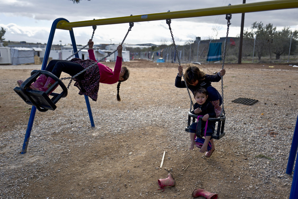 "Photo - Syrian refugee children enjoy a swing ride at the refugee camp of Ritsona about 86 kilometers (53 miles) north of Athens, Saturday, Jan. 14, 2017. The European Commission said conditions for refugees on islands and other camps where they are housed in tents despite severe cold weather, is ""untenable."" (AP Photo/Muhammed Muheisen)"