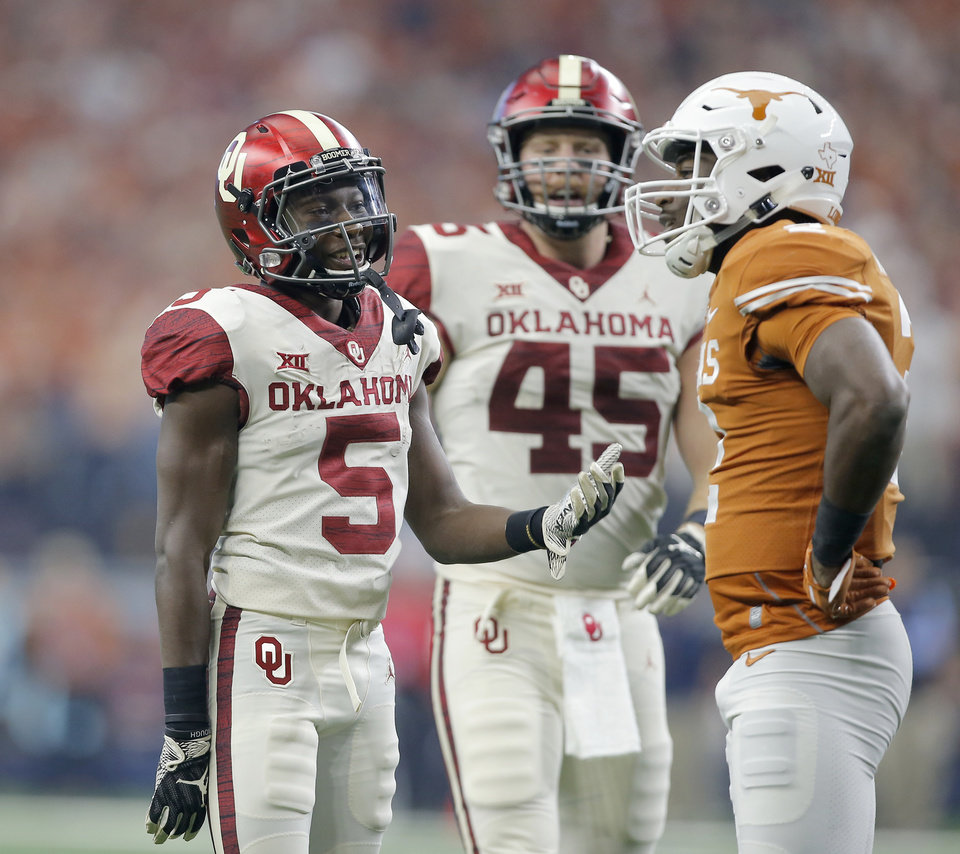 Photo - Oklahoma's Marquise Brown (5) talks with Kris Boyd (2) of Texas during the Big 12 Championship football game between the Oklahoma Sooners (OU) and the Texas Longhorns (UT) at AT&T Stadium in Arlington, Texas, Saturday, Dec. 1, 2018.  Oklahoma won 39-27. Photo by Bryan Terry, The Oklahoman