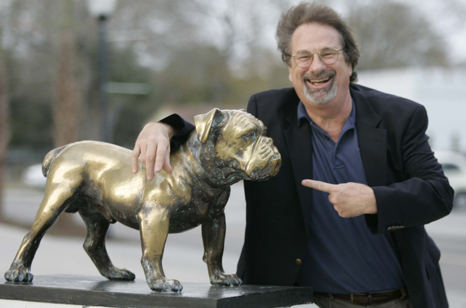 Photo - ** FILE ** Mike Veeck, a co-owner of The Charleston RiverDogs, poses with a bronze statue of The Citadel's mascot on campus Wednesday, Feb. 6, 2008, in Charleston, S.C. Veeck is now bringing his 'Fun' philosophy to the classroom at The Citadel. (AP Photo/Mary Ann Chastain, file)