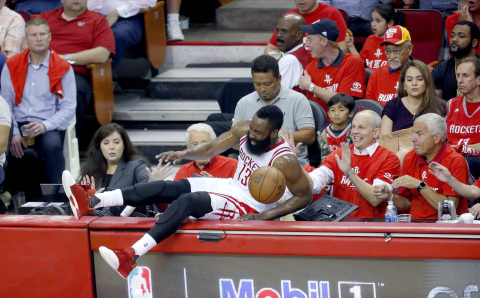 Photo - Houston's James Harden (13) flies into the crowd during Game 2 in the first round of the NBA playoffs between the Oklahoma City Thunder and the Houston Rockets in Houston, Texas,  Wednesday, April 19, 2017.  Photo by Sarah Phipps, The Oklahoman