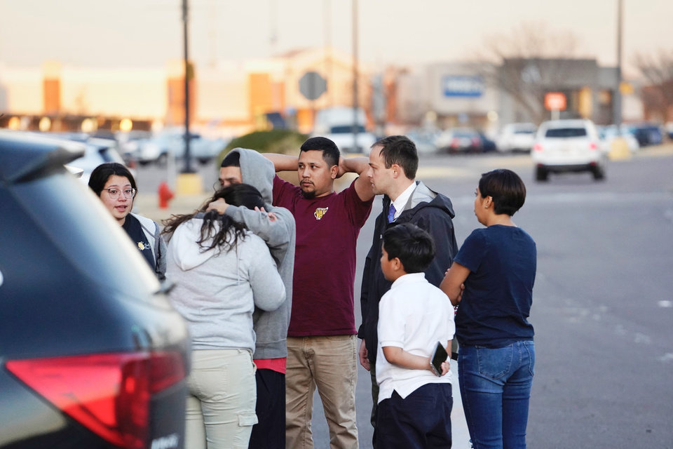 Photo - Bystanders who were in the mall at the time of the shooting embrace after evacuating to the parking lot at Penn Square Mall in Oklahoma City, Oklahoma December 19, 2019.  Nick Oxford, for The Oklahoman