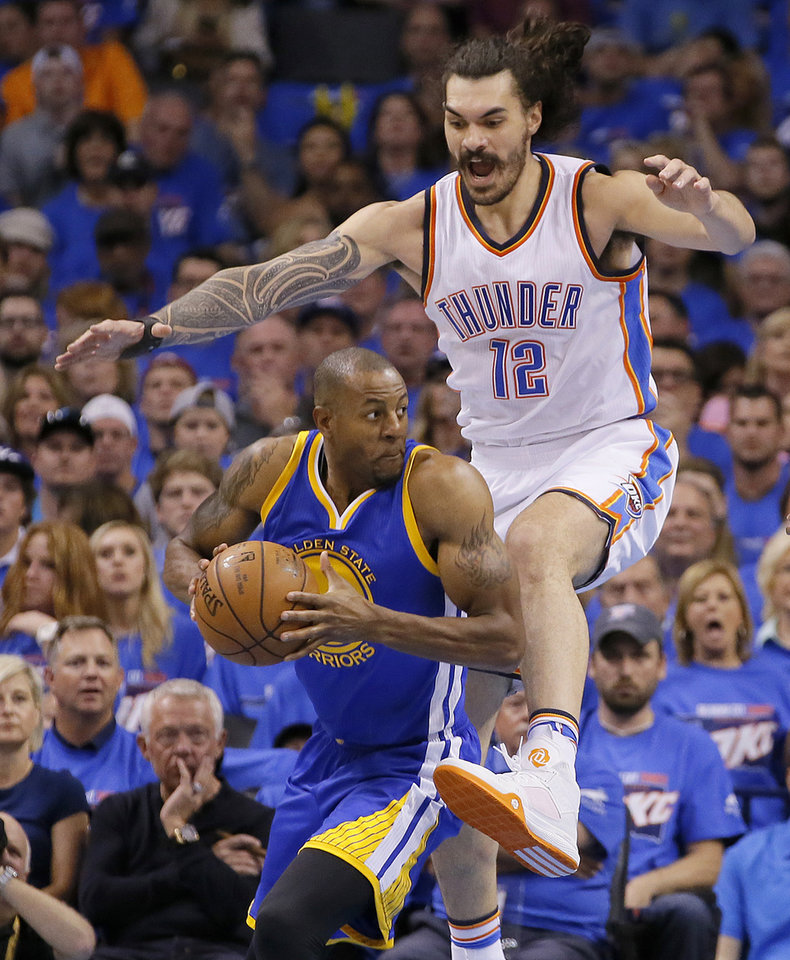 Photo - Oklahoma City's Steven Adams (12) defends Golden State's Andre Iguodala (9) during Game 3 of the Western Conference finals in the NBA playoffs between the Oklahoma City Thunder and the Golden State Warriors at Chesapeake Energy Arena in Oklahoma City, Sunday, May 22, 2016. Oklahoma City won 133-105. Photo by Bryan Terry, The Oklahoman
