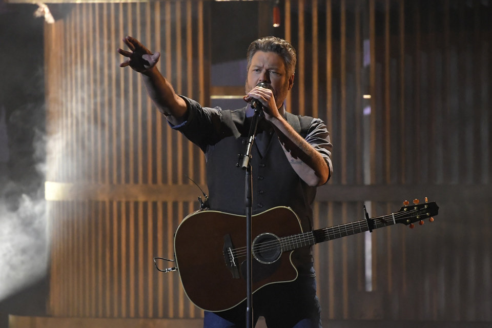 "Photo - Blake Shelton performs ""God's Country"" at the 53rd annual CMA Awards at Bridgestone Arena, Wednesday, Nov. 13, 2019, in Nashville, Tenn. (AP Photo/Mark J. Terrill)"