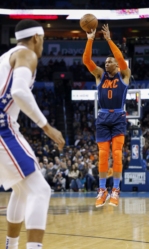Photo - Oklahoma City's Russell Westbrook (0) takes a three-point shot in the first quarter during an NBA basketball game between the Philadelphia 76ers and the Oklahoma City Thunder at Chesapeake Energy Arena in Oklahoma City, Thursday, Feb. 28, 2019. Photo by Nate Billings, The Oklahoman