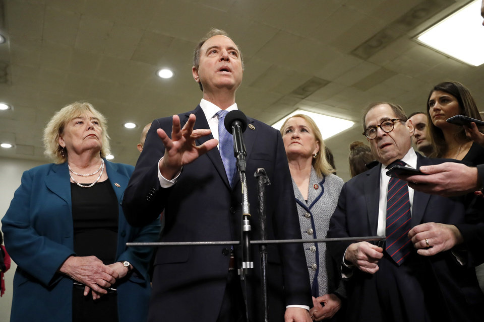 Photo -  House impeachment manager Rep. Adam Schiff, D-Calif., second from left, speaks to reporters while standing with Rep. Zoe Lofgren, D-Calif., from left, and Rep. Sylvia Garcia, D-Texas, and Rep. Jerrold Nadler, D-N.Y., at the U.S. Capitol in Washington, Thursday, Jan. 30, 2020, during the impeachment trial of President Donald Trump on charges of abuse of power and obstruction of Congress. (AP Photo/Julio Cortez)