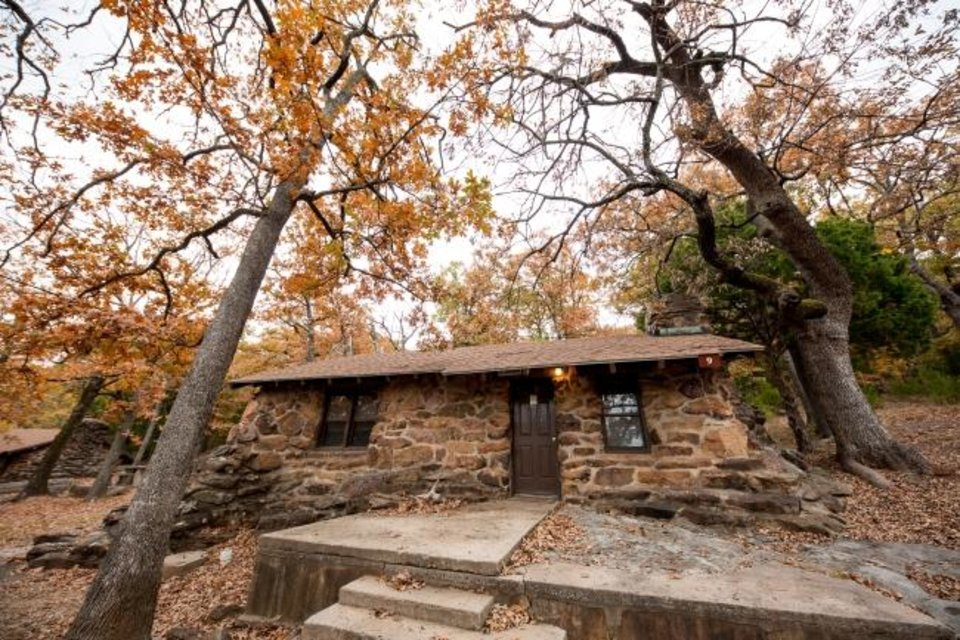 Photo -  The cabins at Greenleaf State Park in Braggs, built in the 1930s, offer vintage exteriors but modern amenities. [Lori Duckworth/Oklahoma Tourism and Recreation Department]
