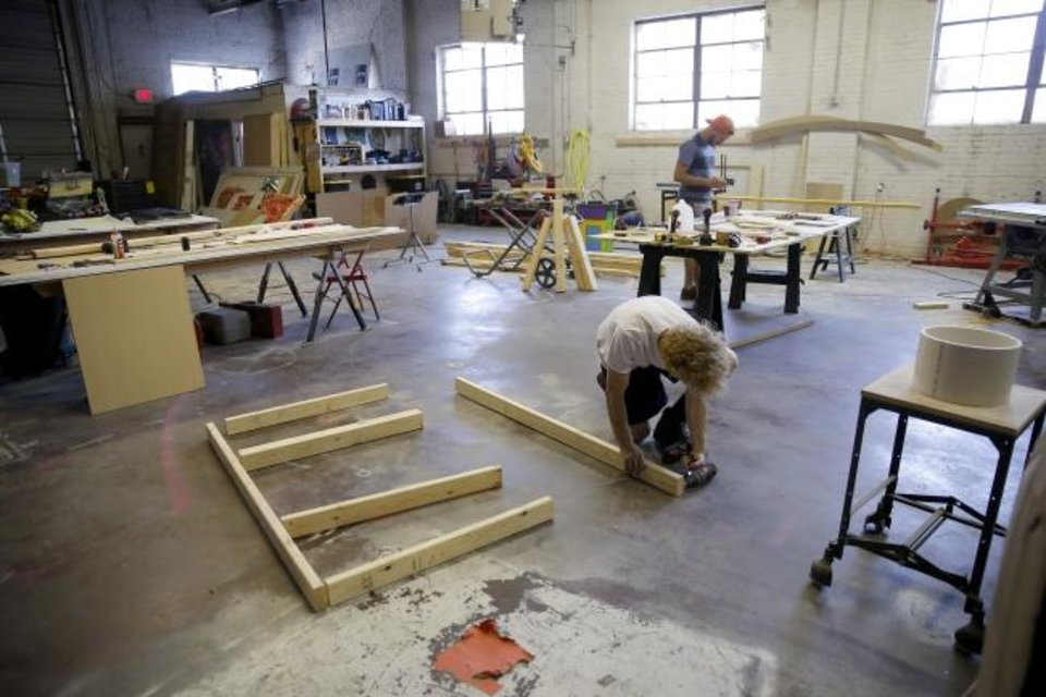 Photo -  Matt Banister, left, and Johnathan Jarmon work on Phase 2 of Factory Obscura's