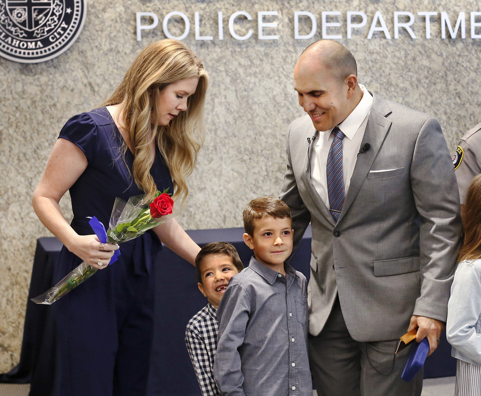 "Photo - Paco Balderrama stands with his wife, Kyla, and their sons, Jenson, 5, and Jude, 6, at the end of his promotion ceremony. The couple's daughter, Hayden, 8, also attended, but she is not shown in this photo.  During a ceremony at Oklahoma City Police headquarters Thursday morning, April 11, 2019, Major Paco Balderrama made history when Chief Bill Citty formally promoted him to the rank of deputy chief, making him the first Hispanic to earn that rank in the department's history. Balderrama is a 20-year veteran of the department and has held various assignments during his time with OCPD. In 2000, Balderrama received the ""Rookie of the Year"" award after his first full year as a police officer. He has lived in Oklahoma City since 1993 and graduated from U.S. Grant High School in 1995. Photo by Jim Beckel, The Oklahoman."