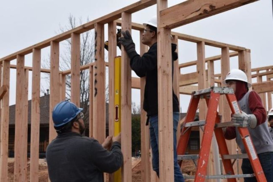 Photo -  Work proceeds on a tiny house for Pivot Inc.'s youth housing program. [PHOTO  PROVIDED]