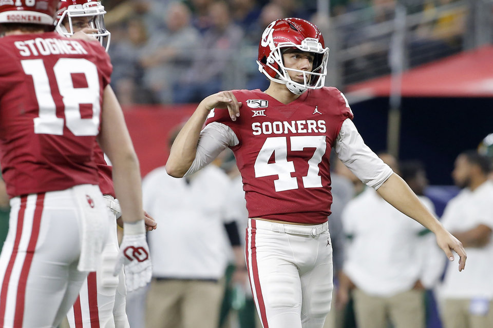 Photo - Oklahoma's Gabe Brkic (47) celebrates after making a field goal during the Big 12 Championship Game between the University of Oklahoma Sooners (OU) and the Baylor University Bears at AT&T Stadium in Arlington, Texas, Saturday, Dec. 7, 2019. Oklahoma won 30-23. [Bryan Terry/The Oklahoman]