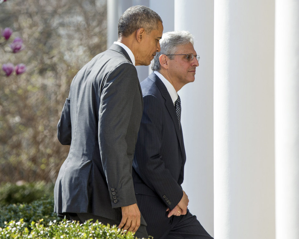 Photo - Federal appeals court judge Merrick Garland, right, departs with President Barack Obama after being introduced as Obama's nominee for the Supreme Court during an announcement in the Rose Garden of the White House, in Washington, Wednesday, March 16, 2016. (AP Photo/Andrew Harnik)