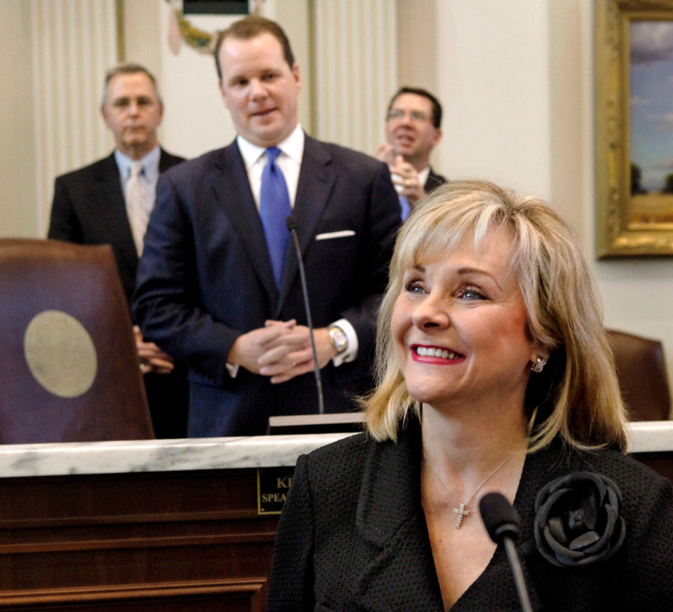 Photo - Gov. Mary Fallin delivers her 2012 State of the State address to a joint session of the Oklahoma legislature in the House Chamber on the opening day of the session, Monday, Feb, 6, 2012.  Behind her are legislative leaders President Pro Tempore Sen. Brian Bingman, left, Lt. Gov. Todd Lamb and House Speaker Kris Steele.  Photo by Jim Beckel, The Oklahoman