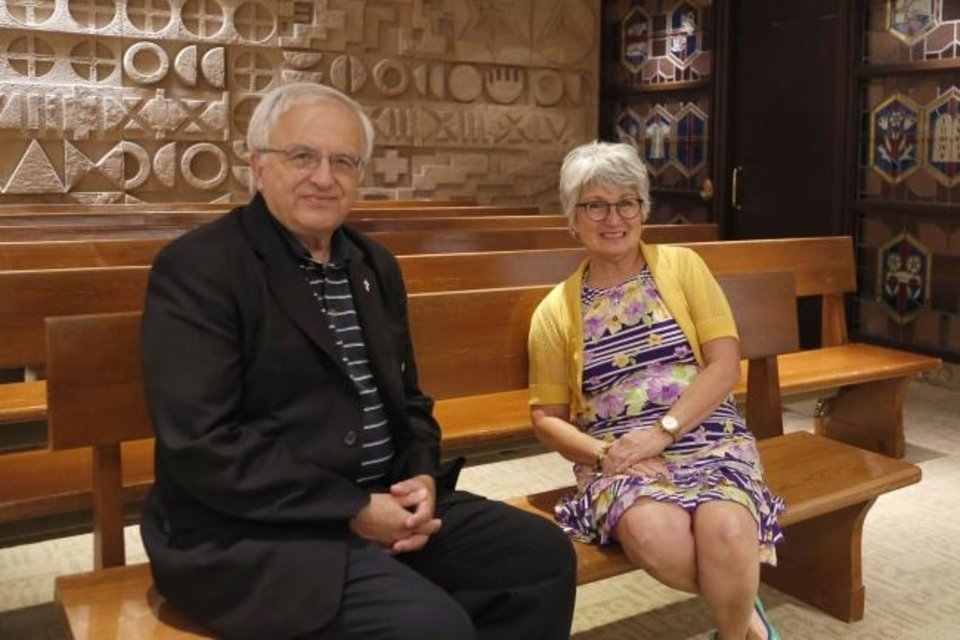 Photo -  Richard Thibodeau, Mercy Hospital's manager of pastoral care, sits in the hospital's chapel with Pat McClure, a volunteer for Mercy's new
