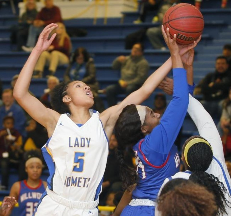 Photo -  Classen SAS' Darianna Littlepage-Buggs of Classen SAS reaches for the ball behind Millwood's Syncere Harrod in February. [Photo by Bryan Terry/The Oklahoman]