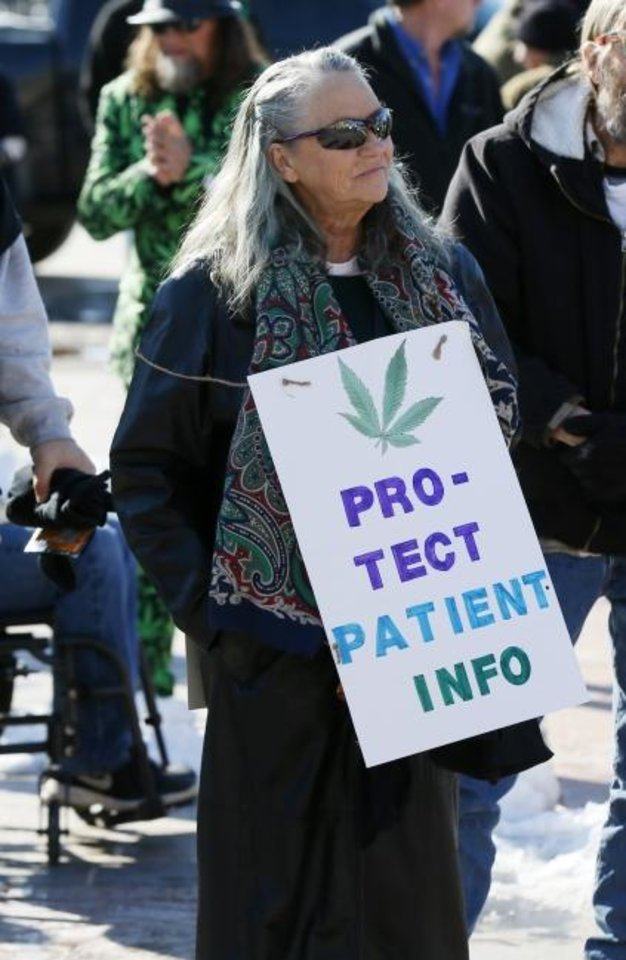 Photo -  Dodie Quinn-Vaughn of Norman, Okla., wears a sign during March the Capitol 2020 at the state Capitol in Oklahoma City, Thursday, Feb. 6, 2020. The rally was to protest many of the bills filed in the legislative session that would affect medical marijuana patients and businesses. [Nate Billings/The Oklahoman]