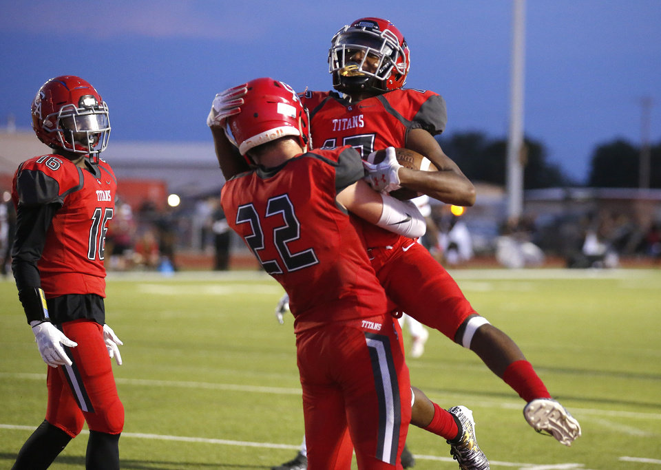 Photo - Carl Albert's Xzavier Thomas (17) celebrates his touchdown with David Peters during the high school football game between Carl Albert and Del City at Carl Albert High School in Midwest City, Okla., Friday, Sept. 13, 2019. [Sarah Phipps/The Oklahoman]